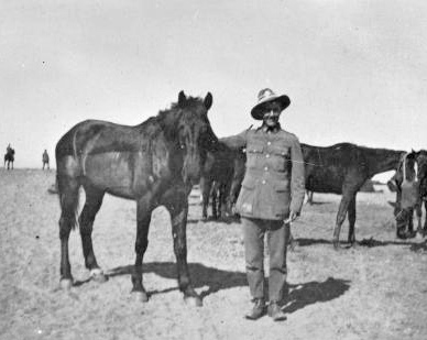 "Unidentified soldier of the Canterbury Mounted Rifles (34th Reinforcements) holding a horse named ""Dick"" in the first half of 1919. © Alexander Turnbull Library"