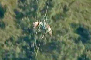 One of the horses is winched to safety in a still from the above video.