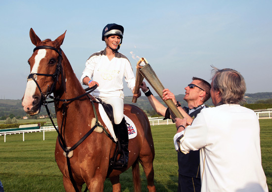 Zara Phillips and Toytown during the Olympic flame's journey to London before the 2012 Games.