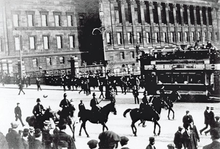 At work in Liverpool.The police are coming down William Brown Street headed toward the Pier Head. St. George's Hall is in the background.