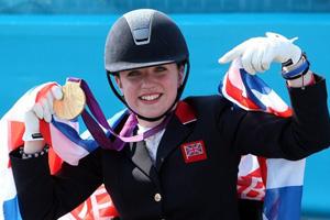 Natasha Baker (GBR) celebrates her Grade II Freestyle gold medal,