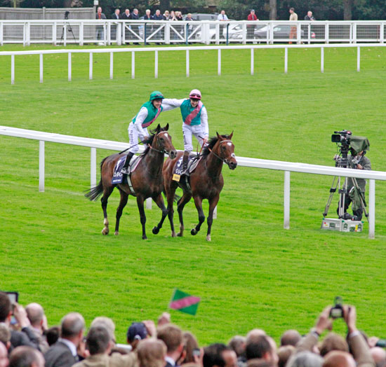 Frankel with Tom Queally, right, and Frankel's older 3/4 brother Bullet Train, who finished third ridden by Ian Mongan.