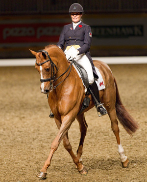 Ashley Holzer and Pop Art danced their way out of competition tonight by once again winning at the Royal. The $20,000 Dominion Regalia Royal Invitational Dressage Cup Freestyle to Music was their last competition together. Image ©BenRadvanyi.com