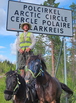 Vaidotas Digaitis, pictured with his horses Kredas and Kaklys,at the Arctic Circle.