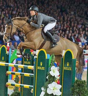 Sweden's Henrik von Eckermann and Gotha FRH on their way to victory in the Mechelen World Cup jumping leg.