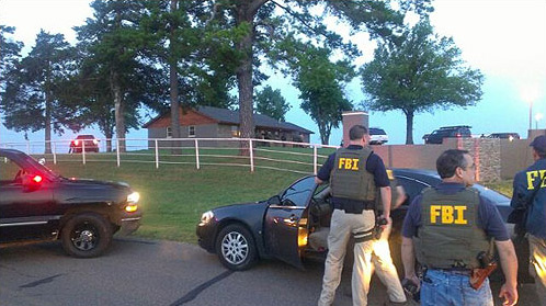 FBI agents at the Oklahoma horse farm that served as a money-laundering front for Los Zetas.