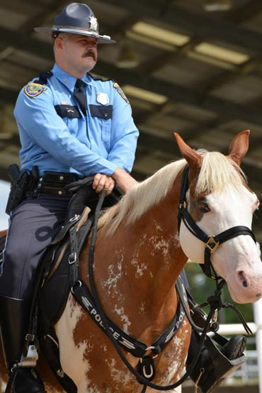 Officer Jeff Harris and Smash at the gelding's graduation ceremony. Photo: Houston Police Department