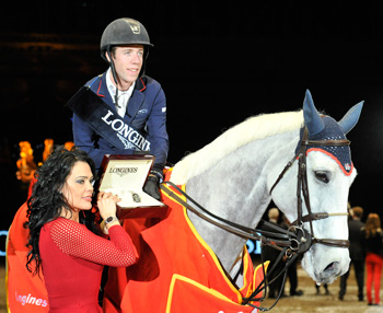 Maikel Van der Vleuten on VDL Groep Sapphire B receives his watch from Katrina Jones of Longines.