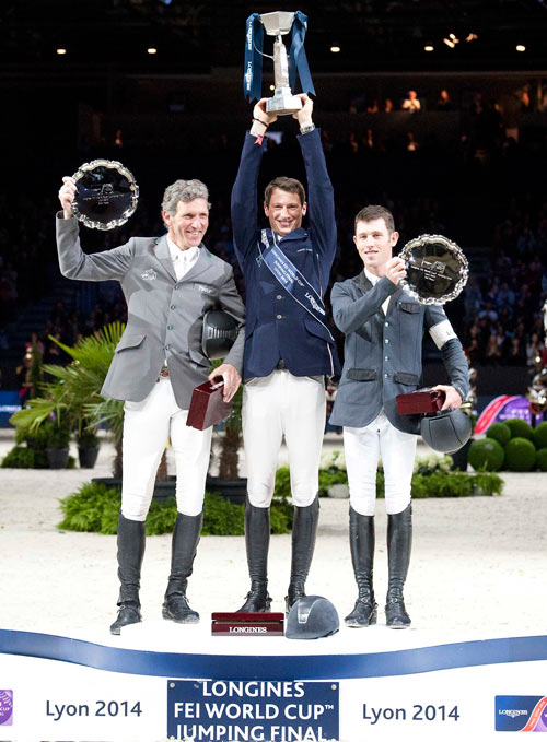 World Cup winner Daniel Deusser is flanked by runner-up Ludger Beerbaum, left, and third placegetter Scott Brash.