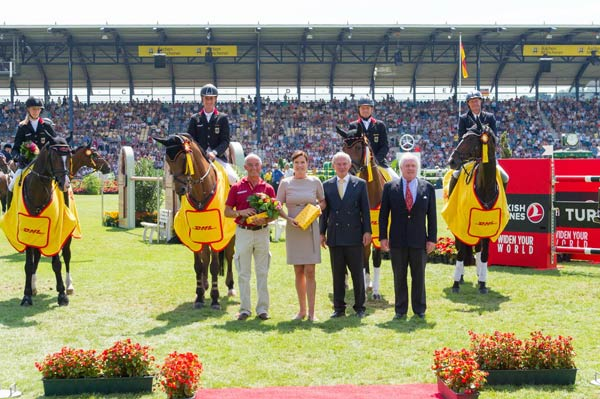 The winning German team, L-R: Sandra Auffarth, Dirk Schrade, Michael Jung and Peter Thomsen, with their chef d'equipe (front left) Hans Melzer receive the honours at Aachen. © Trevor Holt/FEI