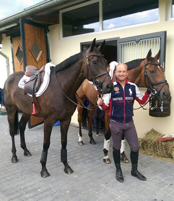 Michael Jung with fischer-Rocana, left, and Sam, after a walk out in the morning.