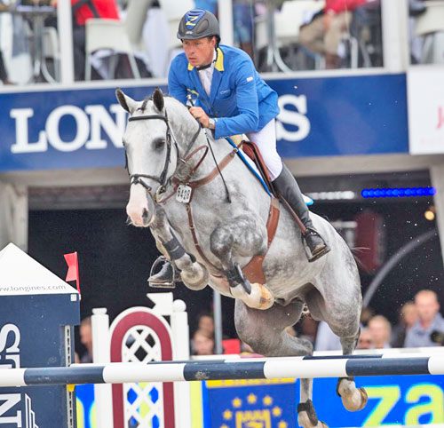 Germany's Christian Ahlmann rode the Westphalian gelding, Hui Buh, to victory in the six-year-old category at the FEI World Breeding Jumping Championships for Young Horses 2014 at Lanaken in Belgium on Sunday. © FEI/Dirk Caremans