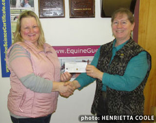 Nancy Kavanagh, Ontario's Equine Foundation of Canada representative and secretary, presents the $16,000 cheque to Equine Guelph director Gayle Ecker. Photo: Henrietta Coole