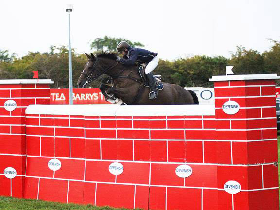 "Liam O'Meara and Cisero,, joint winners of the Devenish Puissance at ""Jumping In The City"" in Cork on Friday night."