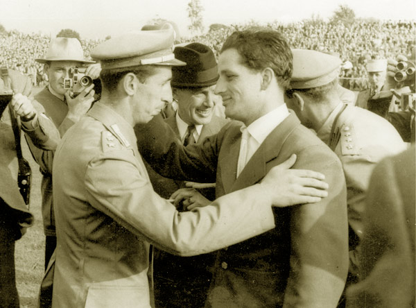 Hans Günter Winkler, right, is congratulated after winning double gold at the World Championships in Aachen in 1955, by Raimondo d'Inzeo.