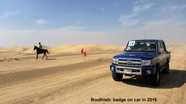At Boutheib, cars have access to the area beside the track only if they have a badge with the rider's number.