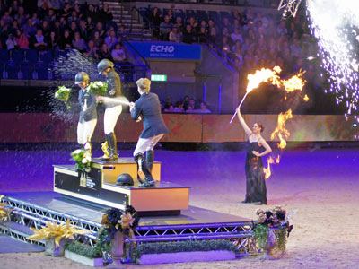 Fireworks, Flame Dancers and being sprayed with Champagne. All part of the great atmosphere at the prizegiving ceremony for CSI under-25 winner Pippa Allen 1st, her sister Millie Allen 2nd and Champagne spraying Harry Charles 3rd. All from Great Britain.