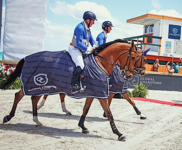 John Whitaker and Lord of Arabia with Bertram Allen and Quiet Easy 4 after winning the weekend's inaugural Global Champions League competition at Miami Beach.