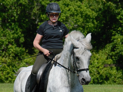 Olwen Busch, a former member of the Northeast Florida Equestrian Society Board of Directors, has been inducted into The Dressage Foundation's Century Club with her horse Filibuster. © Christine Cramer