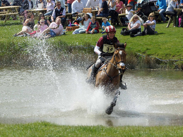 Blyth Tait and Bear Necessity make a splash in the water at Badminton.