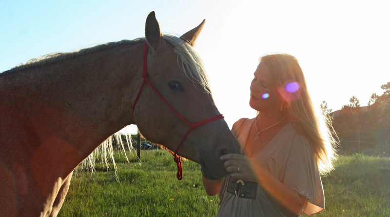 Anna Twinney with her own rescue, Aria, at her home in Elizabeth, Colorado