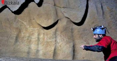 An archaeologist with some of the cave drawings, with a horse at left. Photo: Diputacion Foral de Bizkaia