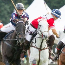 Sunny Hale, in red and white, competing in the 2016 US Open Women's Polo Championship. © Kaylee Wroe.