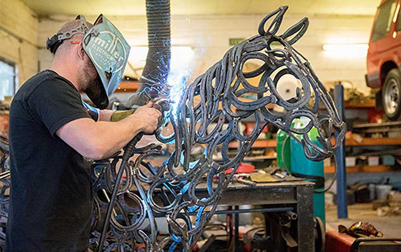Tom Hill works on the sculpture of Clippy. Photos: World Horse Welfare