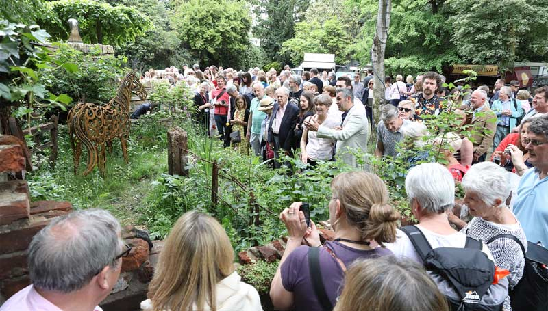 Spectators flocked to the World Horse Welfare Garden at the Chelsea Flower Show, inspired by rescued pony Clippy. Co-designer Jonathan Smith is pictured near the centre of the image, explaining the display to a visitor.
