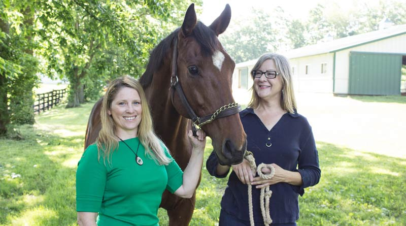 Researchers Karin Pekarchik, left, and Kimberly Tumlin are seeking information on those who participate in horse sports to learn more about the socioeconomic factors about the industry. © Hilary Brown, UK Photo