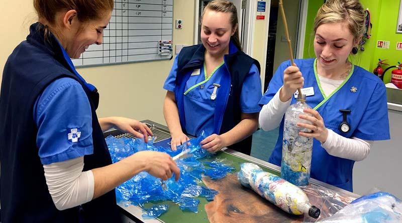 Helen Morris, Kristy Seddon and Keshia Knight from White Cross Vets Liverpool – Gateacre work on their ecobricks.