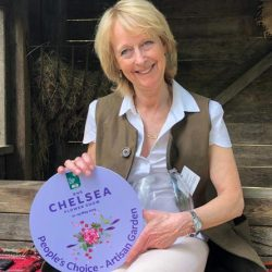"Annie Prebensen of Williams and Prebensen Garden Designs with the Chelsea People's Choice Award for ""Donkeys Matter"". © The Donkey Sanctuary"