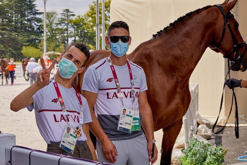 Latvia's Rihards Snikus with Godiva at the horse inspection with Latvia's team veterinarian Jenis Busers.